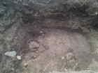 Arkæologisk udgravning mellem jernbanen og Teaterbygningen. Det runde hul er formentlig en 1700-tals latrin.